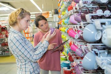 women choosing the cup in a shop