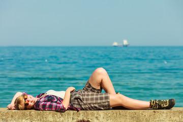 woman hiker relaxing on sea coast