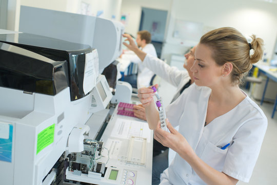 woman scientist working with a device for blood analysis
