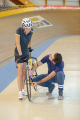 bicyclist and trainer at velodrome
