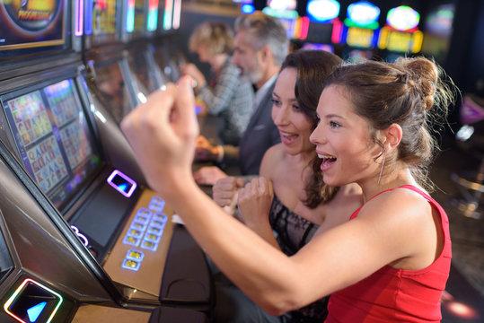 women winning at slot machine