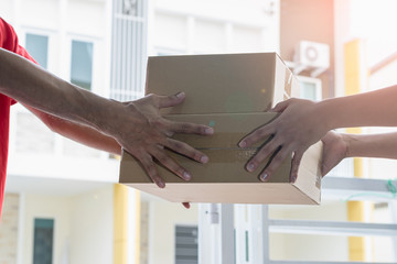 Delivery man are submitting the package to the recipient-Delivery and courier service concepts.