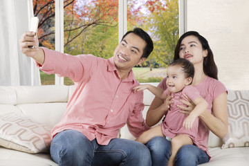 Joyful family taking selfie photo