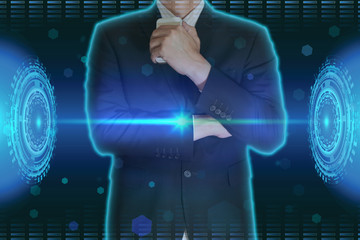 Double exposure of businessman stand up and think idea about business and light blue digital cyber circular transmission background as business, technology and thoughtful concept.