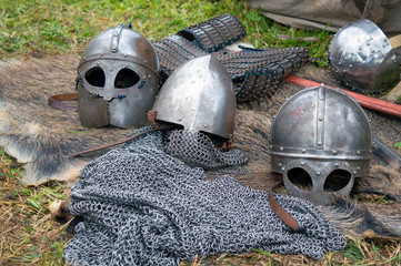 Medieval knight regimentals: metal helmets and chain armour