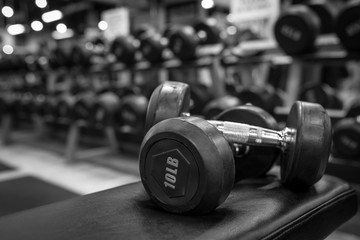 Black and white images dumbbell in the gym bodybuilding.