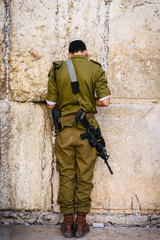 Israeli soldier on Western Wall in Jerusalem, Israel
