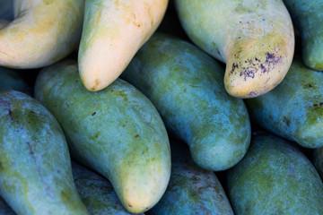 Closeup of fresh Mangoes fruit at the outdoor street food market