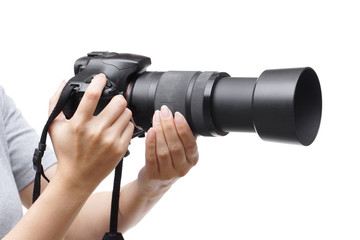 Female hands holding a digital camera with zoom lens