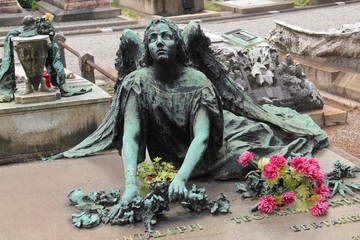 Winged Angel Woman Sculpture in Milan Monumental cemetery