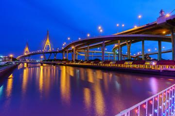 Bhumibol  bridge 2 so called Industrial Ring Bridge crossing The Chao Phraya River with reflection , Bangkok, Thailand ( foreign text saying Bhumibol  bridge 2 )