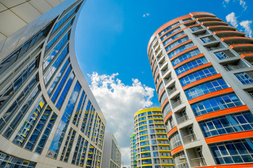 Modern city quarter bottom view against blue sky