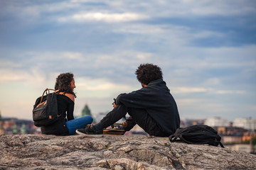 STOCKHOLM, SWEDEN - SEPTEMBER 16, 2016: Tourists couple is enjoying cityscapes of old town from rock