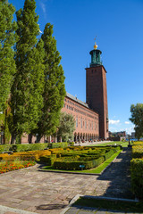 Tower of City Hall with park greenery in Stockholm, Sweden