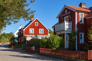 Red Swedish typical house in small town Hedemora