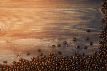 Peaberry coffee beans on wooden background