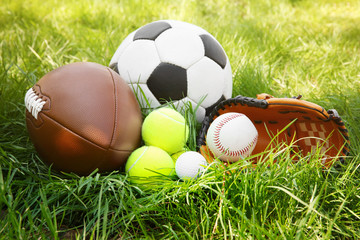 Group of sport equipment on green grass