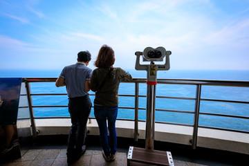 Jun 21, 2017 Tourist couple and telescope seen from Taejongdae observatory in Busan, Korea - seascape