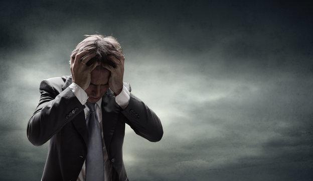 Depressed Businessman With Grunge Cloudscape