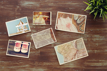 top view of photos collage on wooden background