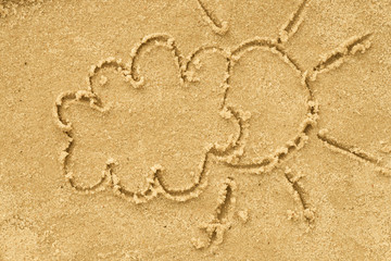cloud and sun drawing in sand