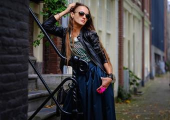 Portrait of a girl model on a city street. Fashion, style, beauty.