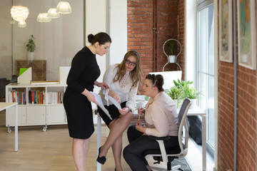 Three business women at the office working