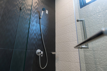 Architecture, new trend design, bathroom of modern house ,interior of modern bathroom , modern shower head in bathroom at home.Modern design of bathroom , shower on tile wall