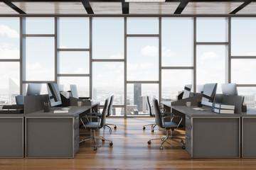 Dark wooden floor open space office, front