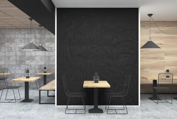 Gray and wooden cafe, black wall, table