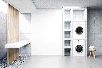 Gray laundry room, sink, washing machine side