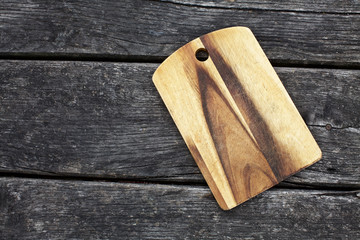 vintage cutting board on old wooden background
