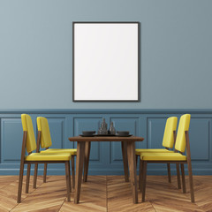 Blue wall dining room, yellow chairs
