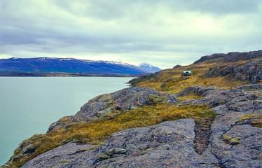 Kleine, einsame Hütte mit grünem Dach am Ufer des Lagarfjót, Ostisland/ Ostfjorde, Island/ Iceland, Europa  Wall mural