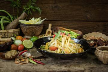 Thai papaya salad material (SomTum) on wooden background