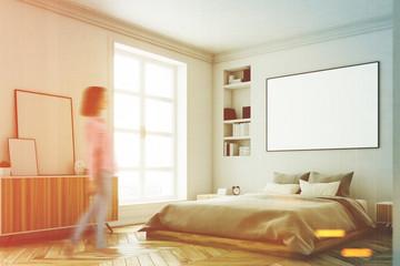 White bedroom interior, woman, corner