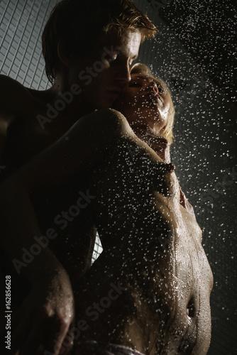 Passionate Couple Having Sex In Shower Studio Shot
