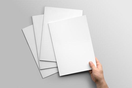 Blank A4 photorealistic brochure mockup on light grey background.