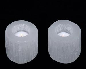 White selenite cylinder tea light holder on black background