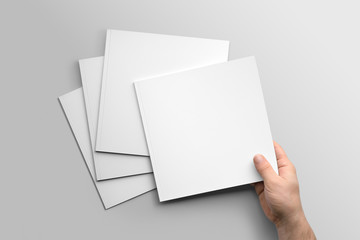 Blank square photorealistic brochure mockup on light grey background.  Wall mural