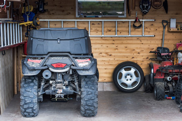 ATV quadbike parked at the garage after ride