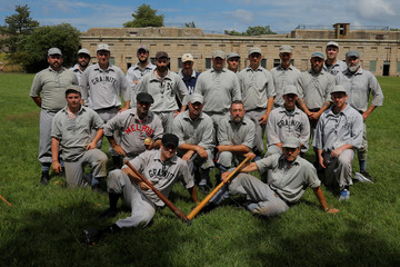 The Providence Grays and the New Hampshire Granite pose for a photograph after playing a pair of vintage baseball games on George's Island in the harbor in Boston