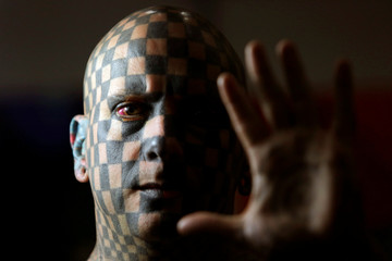 """Matt Gone, also known as """"The Checkered Man"""", poses during the """"Expo Tatuaje"""" international tattoo expo in Monterrey"""