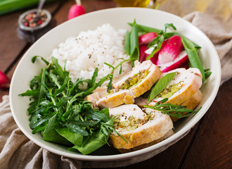 Healthy salad with chicken rolls, radishes, spinach,  arugula and rice. Proper nutrition. Dietary menu