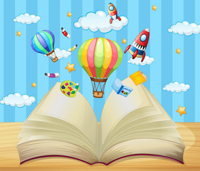 Balloons and rockets flying out of book
