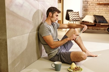 Casual man with tablet at home
