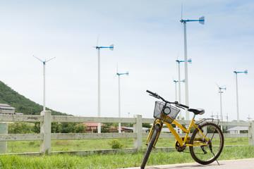 beautiful landscape image with Windturbine and yellow bike
