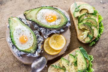 Avocado sandwich and Chicken egg baked in avocado.