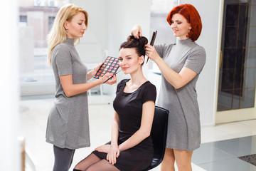 Make-up artist and hairdresser at work