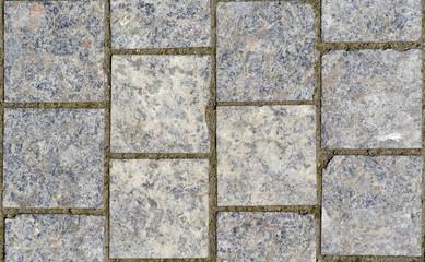Stone pavement texture. Granite cobblestoned pavement background.